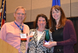 Jeffery Lindoo and Marsha Millonig of MPhA presenting Kristin Janke with the Excellence in Innovation Award.